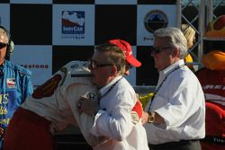 Victory lane: race winner Justin Wilson celebrates with Carl Haas