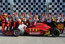 Race winner Justin Wilson celebrates with Carl Haas and Newman/Haas/Lanigan team members