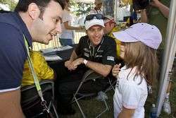 Timo Bernhard talks with a young fan