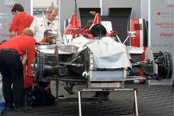 Audi Sport North America team members work on the #2 Audi R10 TDI damaged during the warmup session