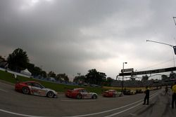 Cars line up on pitlane as the session starts under a menacing sky