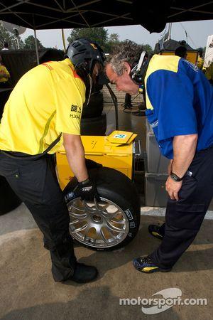 Michelin technician inspects a tire