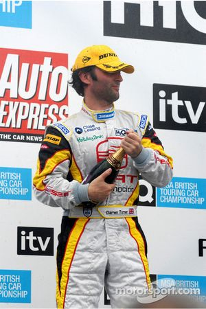 Darren Turner about to spray the champagne