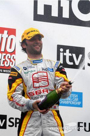 Darren Turner sprays the champagne