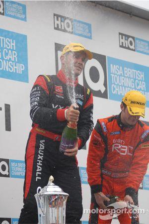 Fabrizio Giovanardi and Colin Turkington spray the champagne