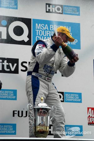 Mat Jackson sprays the champagne