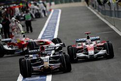 Sebastian Vettel, Scuderia Toro Rosso, STR03 y Jarno Trulli, Toyota Racing, TF108