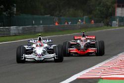 Robert Kubica, BMW Sauber F1 Team, F1.08 leads Heikki Kovalainen, McLaren Mercedes, MP4-23