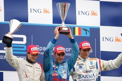 Pastor Maldonado celebrates his victory on the podium with Jerome D'Ambrosio and Vitaly Petrov