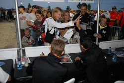 Autograph session: Ryan Briscoe and Helio Castroneves