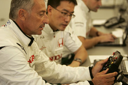 Riccardo Patrese checks the steering wheel of the Honda RA107