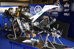 Fiat Yamaha crew members work to prepare team bikes