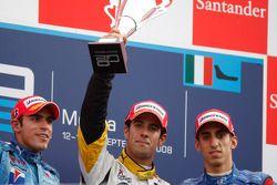 Lucas di Grassi celebrates his victory on the podium with Pastor Maldonado and Sebastien Buemi