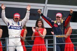 Podium: 1. Sebastian Vettel mit Robert Kubica