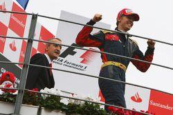 Podium: race winner Sebastian Vettel celebrates