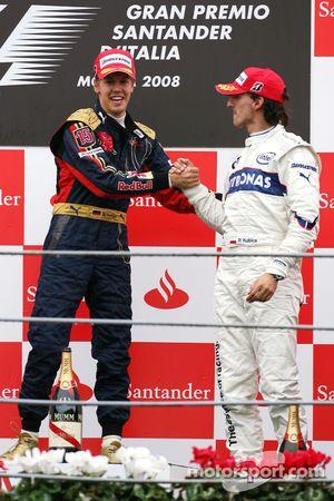 Podium: race winner Sebastian Vettel celebrates with Robert Kubica