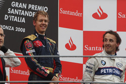 Podium: Le vainqueur Sebastian Vettel et Robert Kubica, troisième