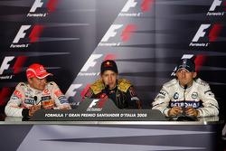Conférence de presse d'après-course: le vainqueur Sebastian Vettel, Heikki Kovalainen, deuxième et Robert Kubica, troisième
