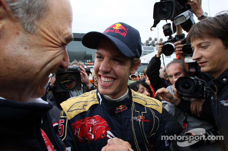 Race winner Sebastian Vettel celebrates with Peter Sauber