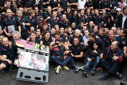 Race winner Sebastian Vettel celebrates with Scuderia Toro Rosso team members