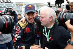 Race winner Sebastian Vettel celebrates with his father Norbert Vettel