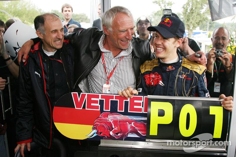 Race winner Sebastian Vettel celebrates with Franz Tost, Scuderia Toro Rosso, Team Principal, and Di