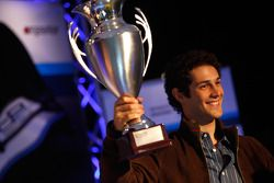Bruno Senna collects his trophy for second position in the Championship
