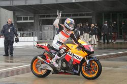 Nicky Hayden waves to the fans after the race