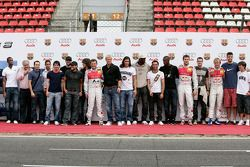 Players of FC Barcelona together with Audi drivers during the official car-hand-over