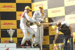 Podium: champagne for Paul di Resta, Timo Scheider and Bernd Schneider