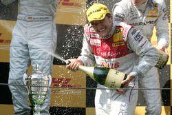 Podium: Timo Scheider sprays champagne
