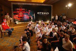 Kimi Raikkonen, Ferrari meets local school children Abu Dhabi Etihad Airways F1 Grand Prix 2009, Emi