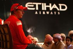 Kimi Raikkonen of Ferrari meets local school children the Abu Dhabi Etihad Airways F1 Grand Prix 200