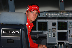 Kimi Raikkonen of Ferrari flys in an Etihad Airways flight simulator over the Yas Island, the site
