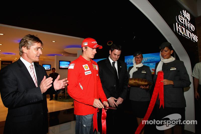 Kimi Raikkonen of Ferrari opens the Etihad Holiday Store at Marina Mall