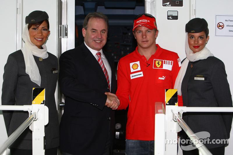 Kimi Raikkonen of Ferrari meets James Hogan, CEO of Ethiad Airways beofre flying in an Etihad Airway