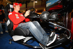 Kimi Raikkonen of Ferrari drives a F1 Simulator at Marina Mall
