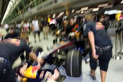 David Coulthard pushed back into the garage by crew members