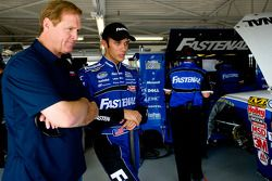Bryan Clauson talks with retired NASCAR driver Rusty Wallace after an accident