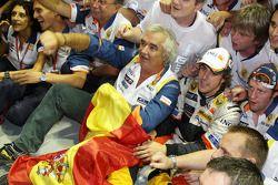 Race winner Fernando Alonso celebrates with Flavio Briatore and Renault F1 team members