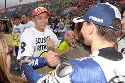 Race winner and 2008 World Champion Valentino Rossi celebrates with Jorge Lorenzo