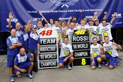 Race winner and 2008 World Champion Valentino Rossi celebrates with Jorge Lorenzo and Yamaha team members