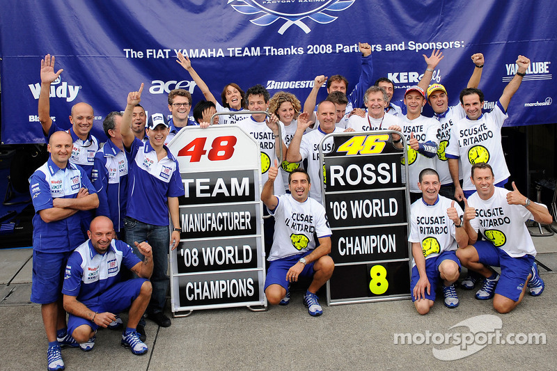 Race winner and 2008 World Champion Valentino Rossi celebrates with Jorge Lorenzo and Yamaha team members