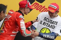 Podium: race winner and 2008 World Champion Valentino Rossi celebrates with Casey Stoner