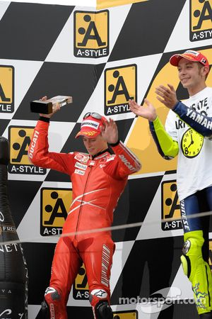 Podium: race winner and 2008 World Champion Valentino Rossi with second place Casey Stoner