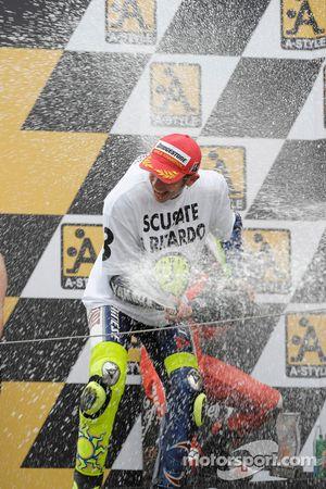Podium: race winner and 2008 World Champion Valentino Rossi sprays champagne