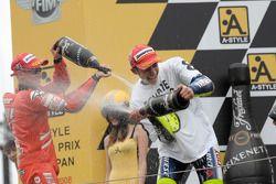 Podium: champagne for Valentino Rossi and Casey Stoner