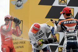 Podium: champagne for Valentino Rossi, Casey Stoner and Dani Pedrosa