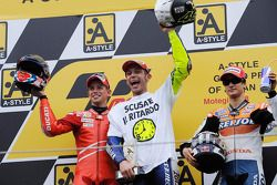 Podium: race winner and 2008 World Champion Valentino Rossi, second place Casey Stoner, third place