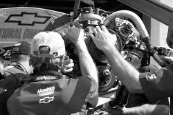 Hendrick crew members change the motor on the car of Dale Earnhardt Jr.
